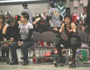 Susie No Skates (grey t-shirt) waiting for an ADRD blocker to time, while Anna Rexxxit sits in the sin-bin.